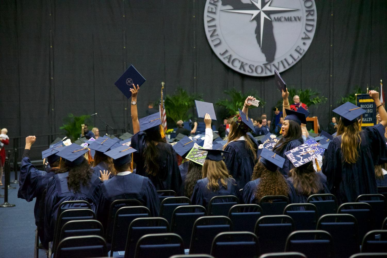Graduates+celebrating+their+hard+work.