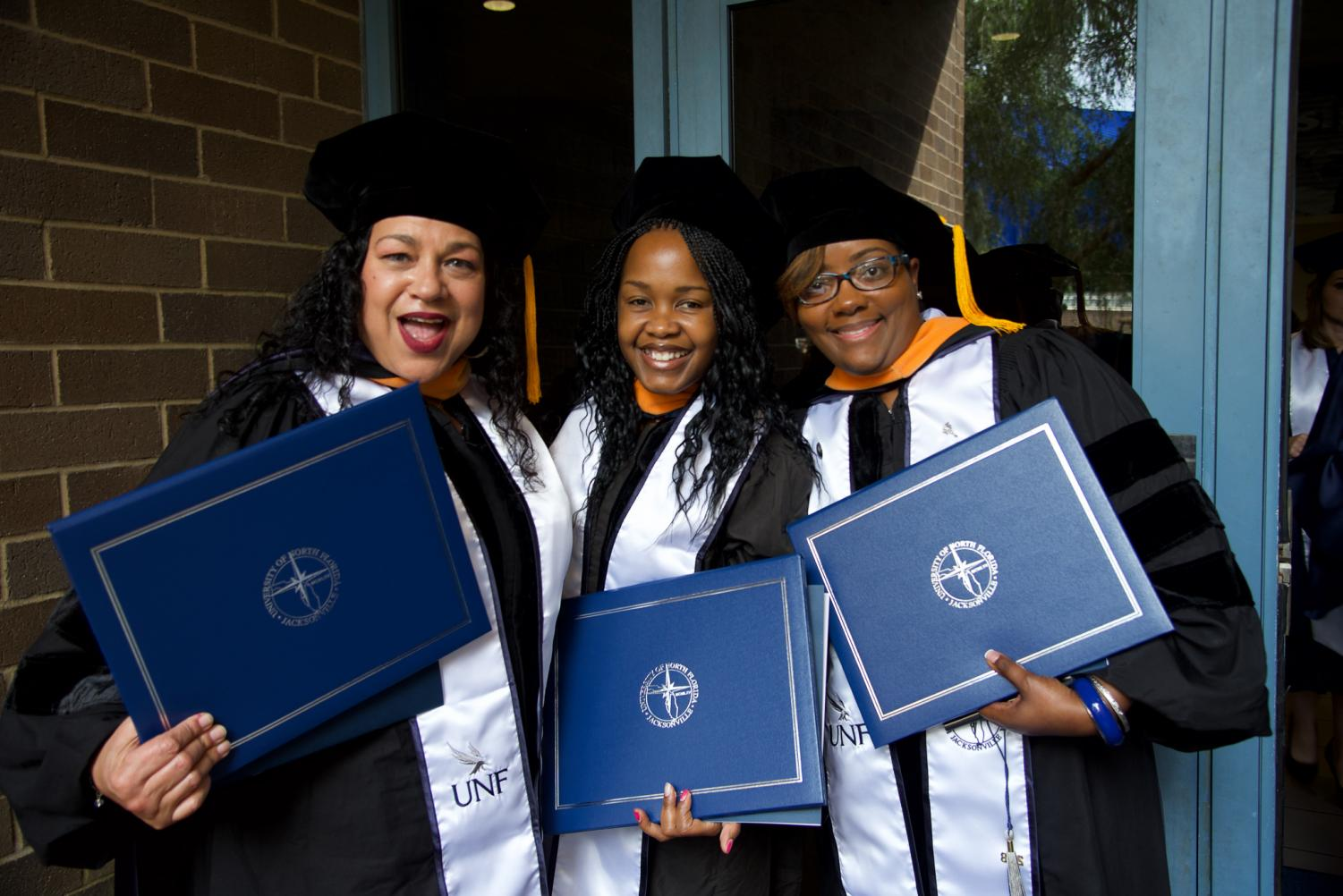 Brooks+College+of+Health+Doctoral+graduates+proudly+displying+their+degrees.