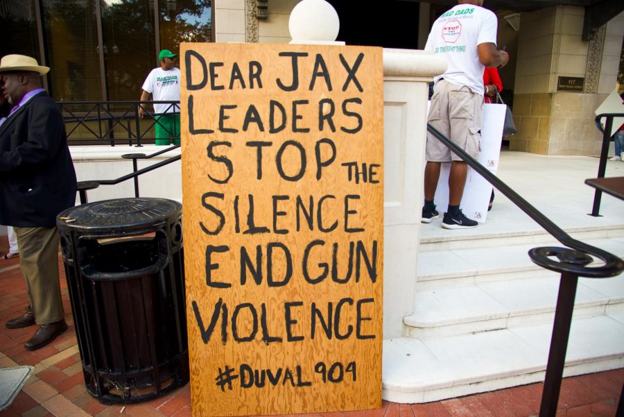Sign placed outside of City Hall in support of ending gun violence.
