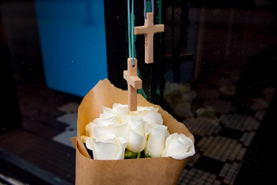 Flowers and crosses in remembrance of those who lost their lives in The Landing shooting.