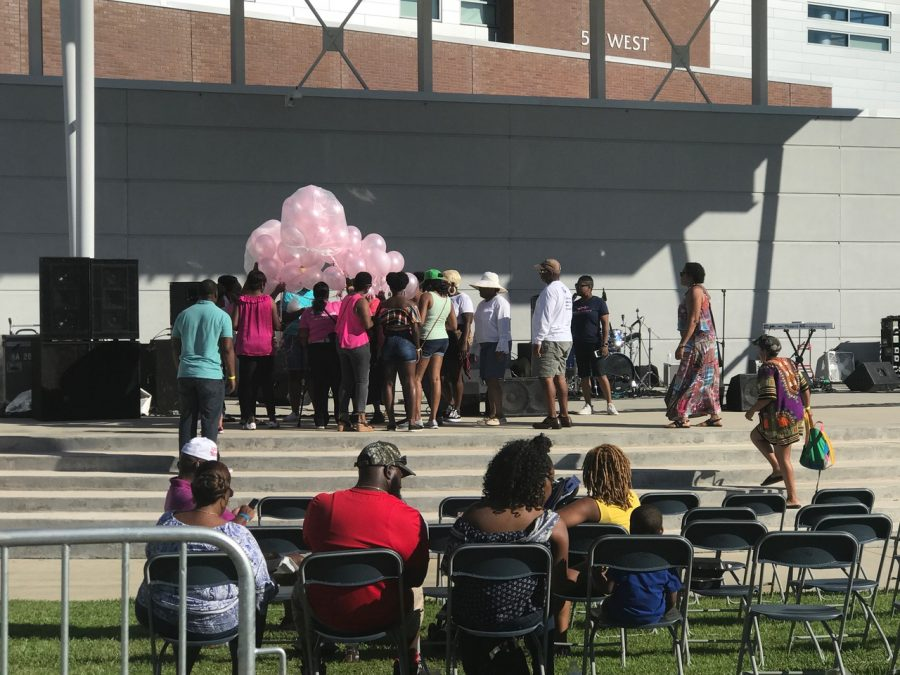Pink balloons are brought out for a balloon send off for those who have died from breast cancer.