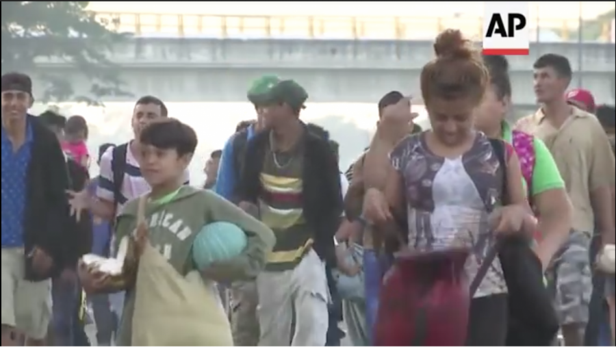 Thousands of migrants are heading towards the U.S. border. Courtesy Associated Press YouTube.
