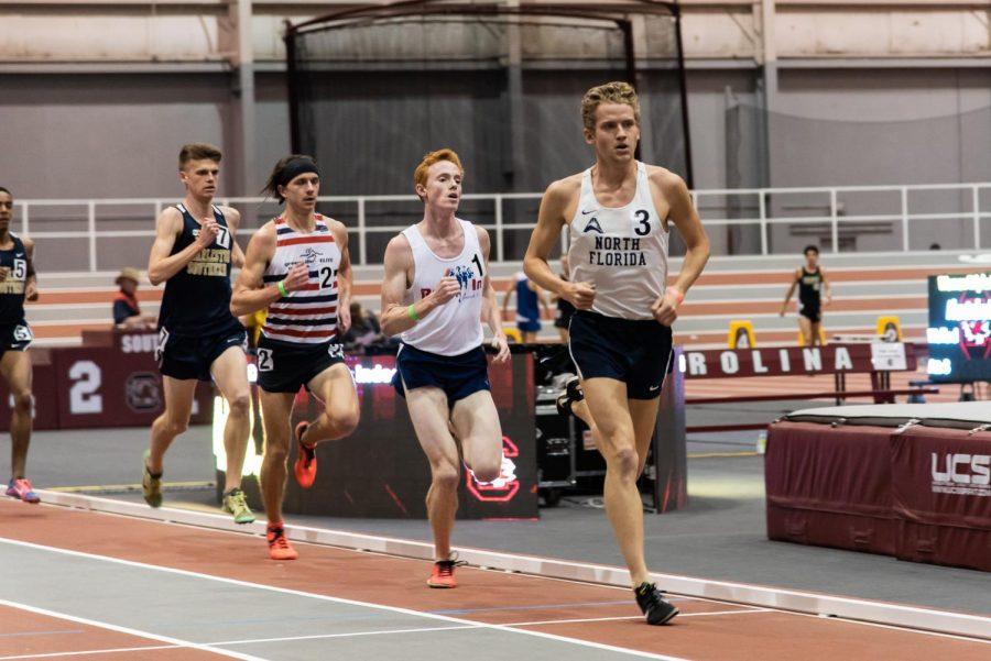 Junior Noah Perkins races toward the finish line