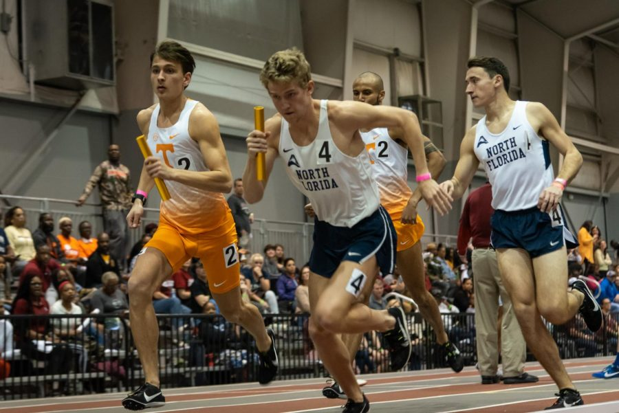 Junior Noah Perkins races after receiving the baton.