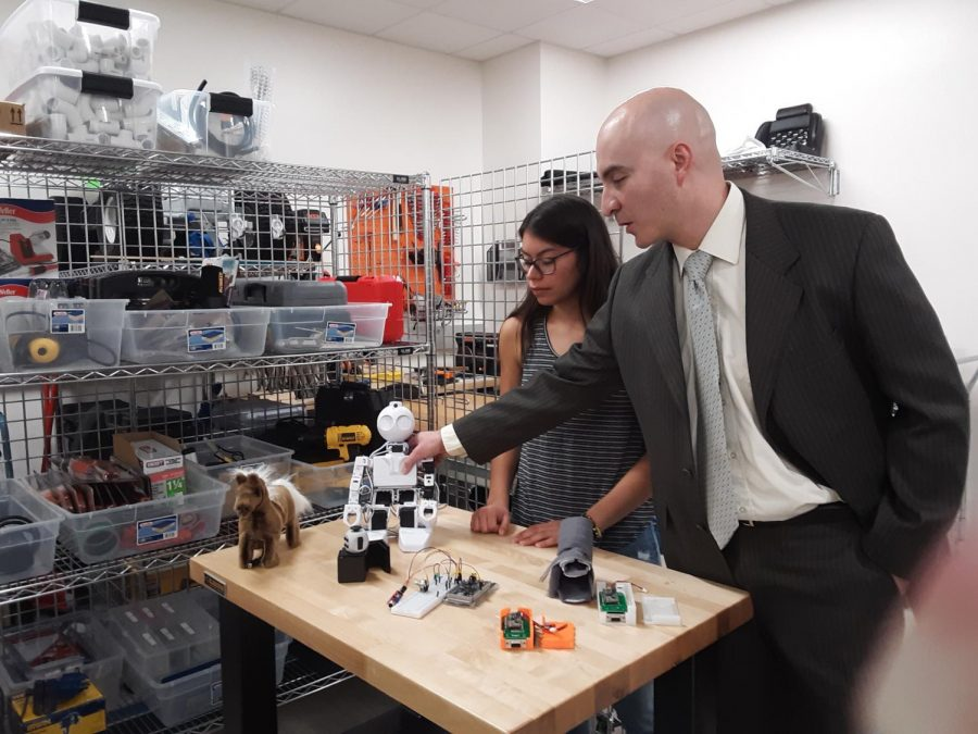 Dr. Juan Aceros demonstrates the adaptive toys.