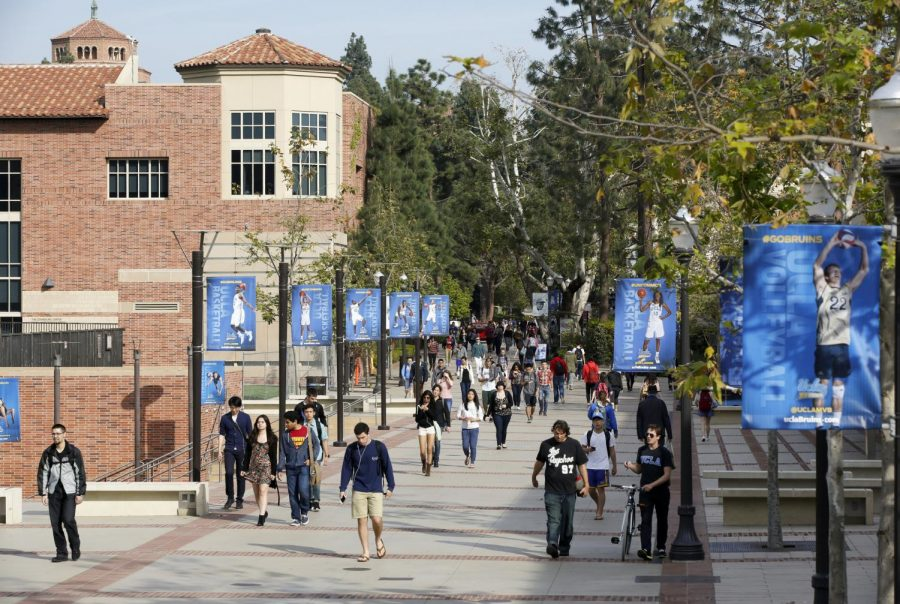 In this Feb. 26, 2015, file photo, students walk on the University of California, Los Angeles campus. Federal authorities have charged college coaches and others in a sweeping admissions bribery case in federal court. The racketeering conspiracy charges were unsealed Tuesday, March 12, 2019, against coaches at schools including UCLA, Wake Forest, Stanford, Georgetown, and the University of Southern California. (AP Photo)