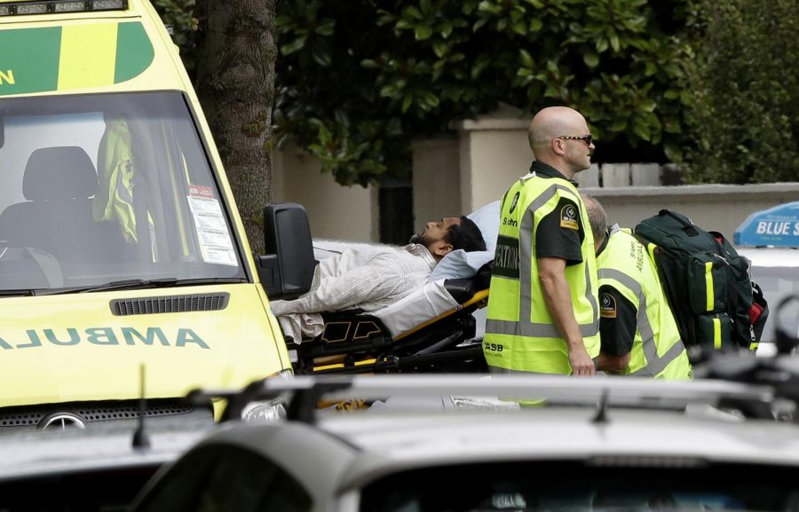 Ambulance staff take a man from outside a mosque in central Christchurch, New Zealand, Friday, March 15, 2019. A witness says many people have been killed in a mass shooting at a mosque in the New Zealand city of Christchurch.