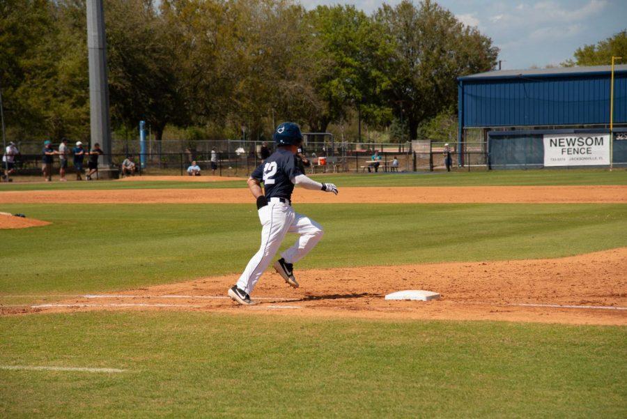 Senior Jay Prather rounds first base.