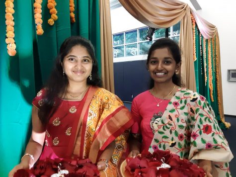 The first dancers of the evening, Annie Thomas and Sai Spurthi Ravi, greeted guests by placing bindi red dots on their foreheads.
