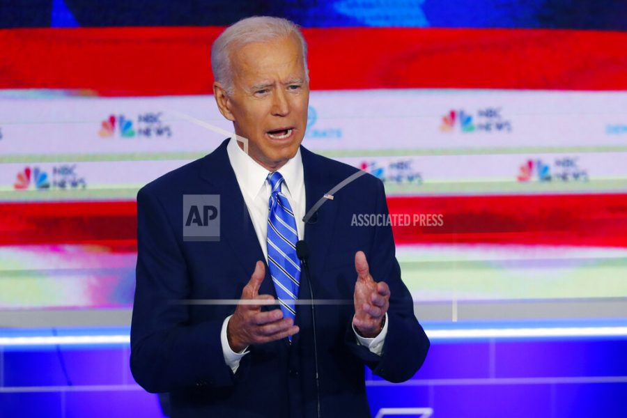 The Latest: Biden says Harris misrepresented busing stance