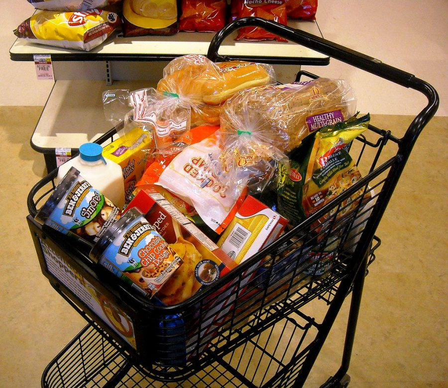 Grocery cart full of processed foods