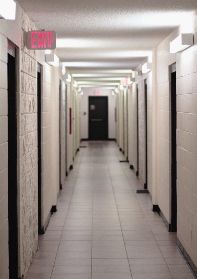 Dorm hallway leading to exit door