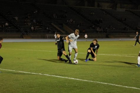 Bryson Smith challenges a defender inside the box.