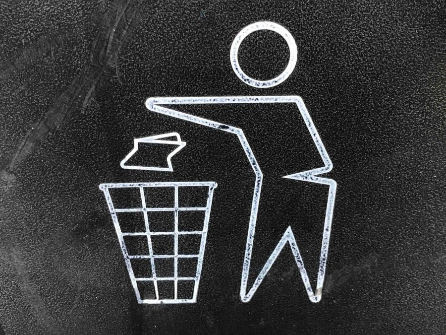 A graphic of a person throwing trash into a waste bin.