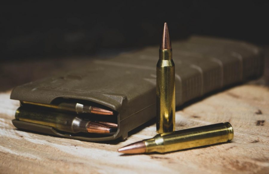 brass colored bullets in a magazine