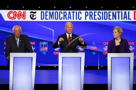 Democratic presidential candidate Sen. Bernie Sanders, I-Vt., left, former Vice President Joe Biden and Sen. Elizabeth Warren, D-Mass., right, participate in a Democratic presidential primary debate hosted by CNN/New York Times at Otterbein University, Tuesday, Oct. 15, 2019, in Westerville, Ohio. (AP Photo/John Minchillo)