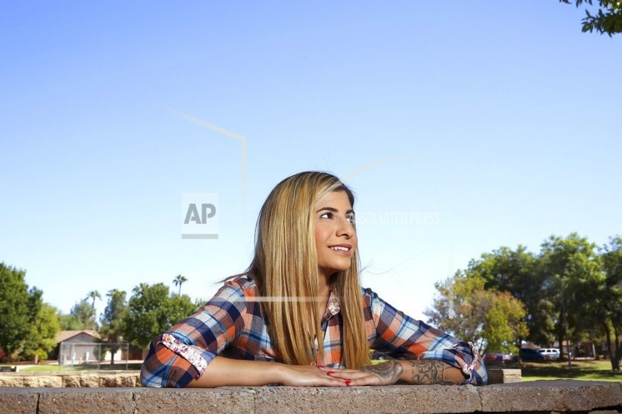 In this Tuesday, Oct. 15, 2019 photo, college student, Sheida Assar, poses for a photo in Chandler, Ariz. Assar said she was expelled from GateWay Community College in Phoenix last month for violating the school's drug policy after she tested positive for marijuana, which she uses to treat chronic pain from polycystic ovary syndrome. (AP Photo/Ross D. Franklin)