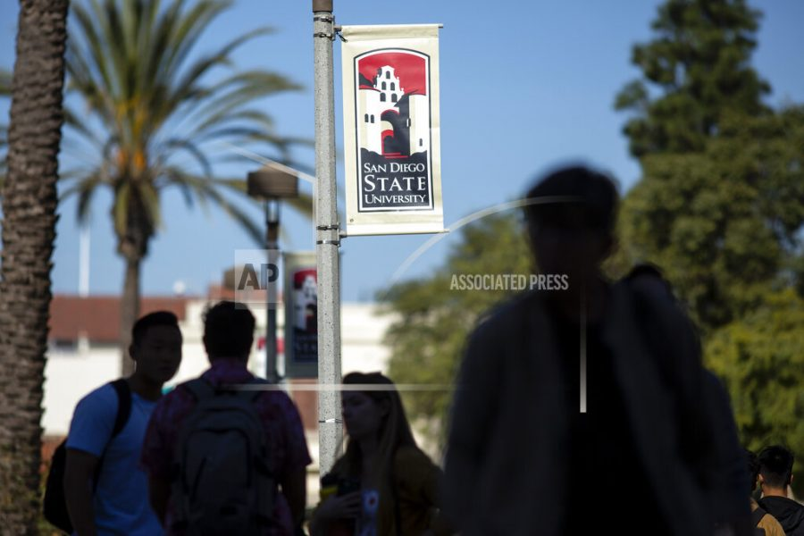 People walk on campus at San Diego State University Tuesday, Nov. 12, 2019, in San Diego, Calif. San Diego State University says a freshman who was hospitalized after attending a fraternity party last week has died. University President Adela de la Torre announced Monday that 19-year-old Dylan Hernandez died Sunday, Nov. 10, 2019 surrounded by his family.The university says its police are investigating the death but gave no further details about possible causes. (AP Photo/Gregory Bull)