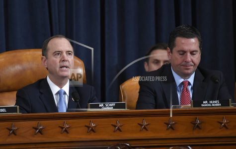 House Intelligence Committee Chairman Adam Schiff of Calif., left, speaks as Rep. Devin Nunes, R-Calif., the ranking member on the committee listens during the House Intelligence Committee on Capitol Hill in Washington, Wednesday, Nov. 13, 2019, in the first public impeachment hearing of President Donald Trump's efforts to tie U.S. aid for Ukraine to investigations of his political opponents. (AP Photo/Susan Walsh)