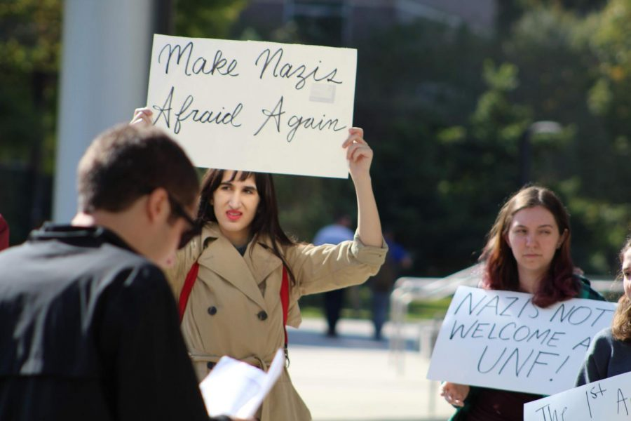 A+student+with+an+anti-neo-Nazi+sign.+Photo+credit+Ethan+Mclaughlint.