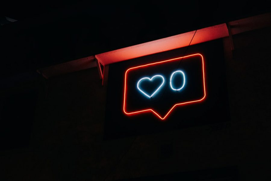photo of glow in the dark sign of instagram like