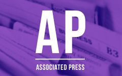 AP: Global stocks mostly slip as virus weighs on companies