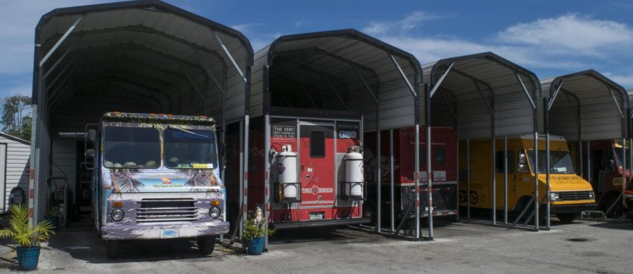 Food trucks parked in covered bays. Photo credit Christian Ayers.