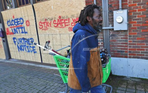AP: A record 6.6 million seek US jobless aid as layoffs mount