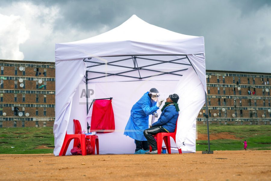 A residents from the Alexandra township gets tested for COVID-19 , in Johannesburg, Wednesday, April 29, 2020. South Africa will begin a phased easing of its strict lockdown measures on May 1, although confirmed cases of coronavirus continue to increase. (AP Photo/Jerome Delay)