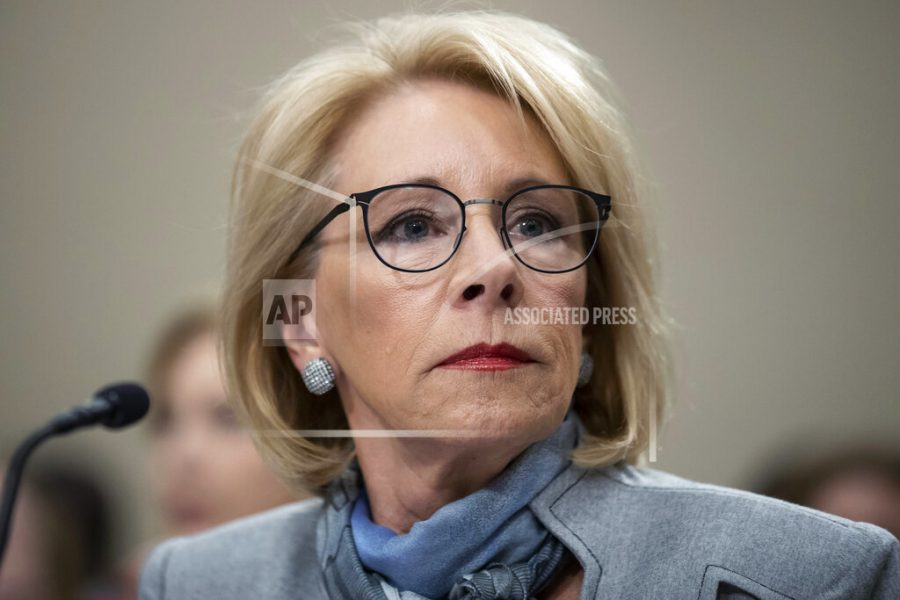 FILE - In this Feb. 27, 2020, file photo, Education Secretary Betsy DeVos pauses as she testifies during a hearing of a House Appropriations Sub-Committee on the fiscal year 2021 budget on Capitol Hill in Washington. The Trump administration is barring most international students and all students who entered the U.S. illegally from receiving emergency college grants approved by Congress as part of a $2.2 trillion coronavirus rescue package. DeVos issued the restriction in new guidelines released Tuesday, April 21, 2020, telling colleges how to distribute more than $6 billion in grants meant to help students cover unexpected costs triggered by the pandemic. (AP Photo/Alex Brandon, File)