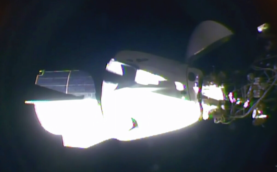 AP: SpaceX's astronaut-riding Dragon arrives at space station