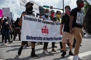 SDS joins Jacksonville protest (photo by Matthew St. Jean).