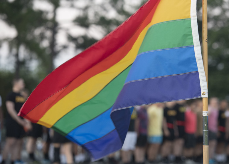 A rainbow flag waves at the starting line of a Pride Observance Month 5K run at Joint Base Langley-Eustis, Virginia, June 21, 2019. The rainbow flag is displayed at lesbian, gay, bisexual, transgender and queer or questioning events worldwide as a symbol for diversity in the LGBTQ community. (U.S. Air Force photo by Airman 1st Class Monica Roybal)