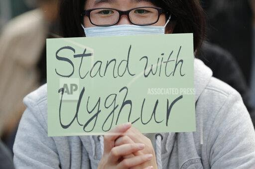 A man holds a sign during a rally to show support for Uighurs and their fight for human rights in Hong Kong. Nury Turkel, co-founder of the Uyghur Human Rights Project and former president of the Uyghur American Association, is a new member of the U.S. Commission on International Religious Freedom. He's a leading human rights advocate on behalf of fellow Uighurs, a Muslim ethnic minority group that has seen an estimated 1 million members detained in internment camps in China. (AP Photo/Lee Jin-man, File)