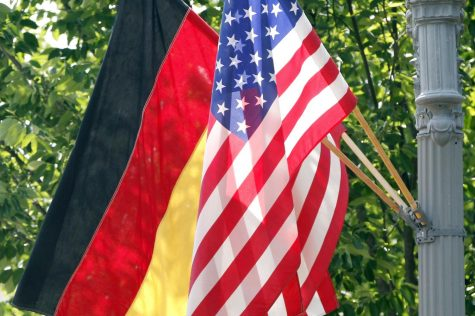 FILE - In this June 6, 2011 file photo, the German and U.S. flags fly on a lamp post in front of the White House in Washington ahead of German Chancellor Angela Merkel