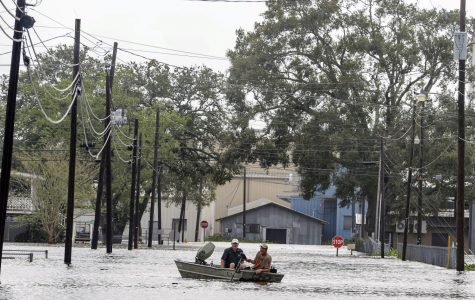 Boaters navigate a flooded road following Hurricane Laura, Thursday, Aug. 27, 2020 in Delcambre, La. (Brad Bowie/The Advocate via AP)