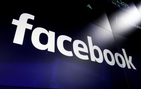 """FILE - This March 29, 2018 file photo, shows the logo for social media giant Facebook at the Nasdaq MarketSite in New York's Times Square. With just two months left until the U.S. presidential election, Facebook says it is taking additional steps to encourage voting, minimize misinformation and reduce the likelihood of post-election """"civil unrest."""" The company said Thursday, Sept. 3, 2020, it will restrict new political ads in the week before the election and remove posts that convey misinformation about COVID-19 and voting. (AP Photo/Richard Drew, File)"""