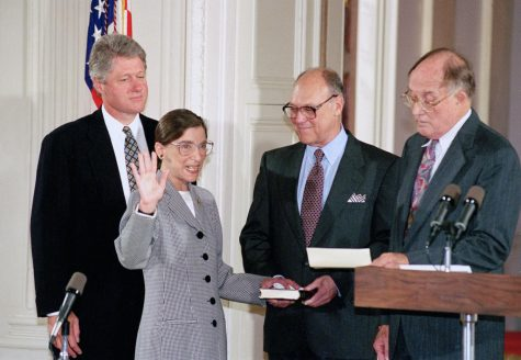FILE - In this Aug. 10, 1993, file photo, Supreme Court Justice Ruth Bader Ginsburg takes the court oath from Chief Justice William Rehnquist, right, during a ceremony in the East Room of the White House in Washington. Ginsburg
