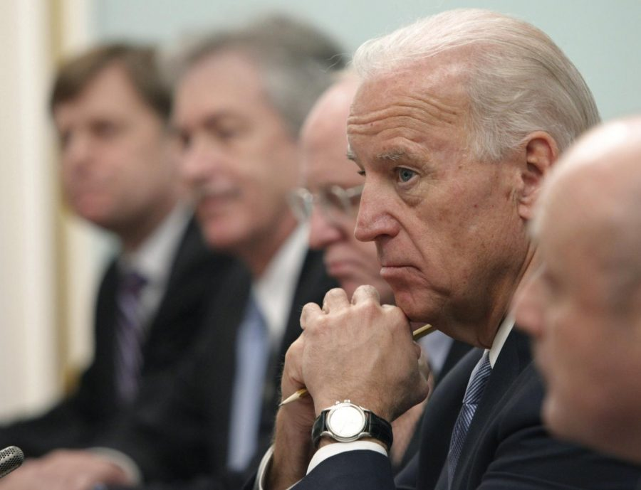 FILE - In this March 10, 2011, file photo, Vice President of the United States Joe Biden, listens to Russian Prime Minister Vladimir Putin, during their meeting in Moscow, Russia. Putin won't congratulate President-elect Joe Biden until legal challenges to the U.S. election are resolved and the result is official, the Kremlin announced Monday, Nov. 9, 2020. (AP Photo/Alexander Zemlianichenko, File)