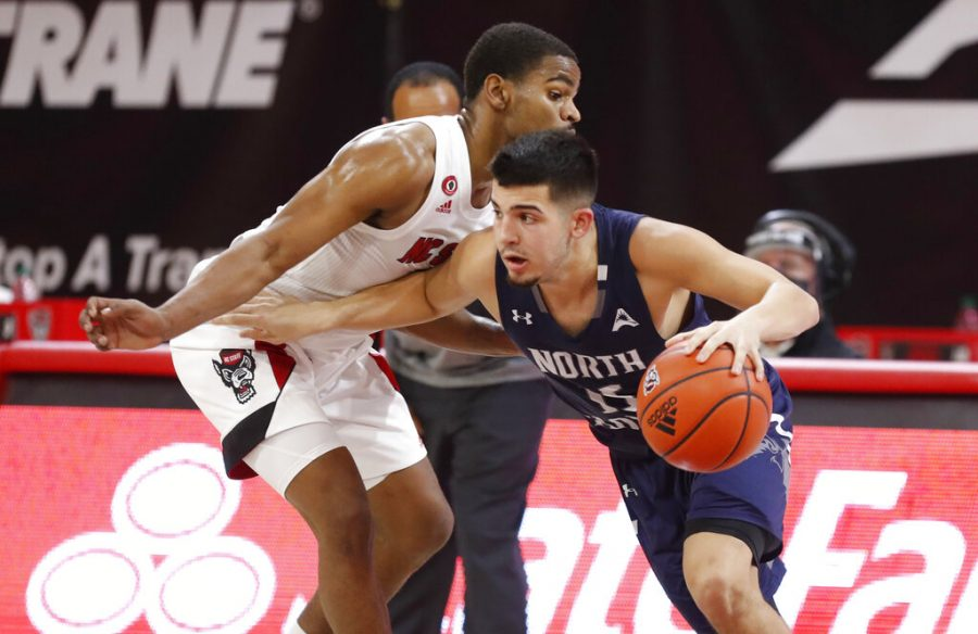 North Florida's Jose Placer (15) scored a career-high 26 points for the Ospreys, but it wasn't enough as UNF fell to Flagler on Saturday afternoon. (Ethan Hyman/The News & Observer via AP)