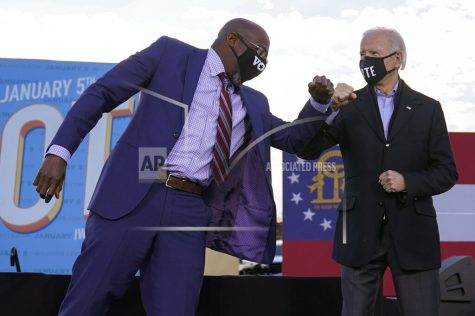 President-elect Joe Biden elbow bumps Senate candidate Raphael Warnock in Atlanta, Monday, Jan. 4, 2021, during a campaign rally for Warnock and Jon Ossoff. (AP Photo/Carolyn Kaster)