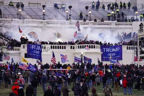 Violent protesters, loyal to President Donald Trump, storm the Capitol, Wednesday, Jan. 6, 2021, in Washington. It