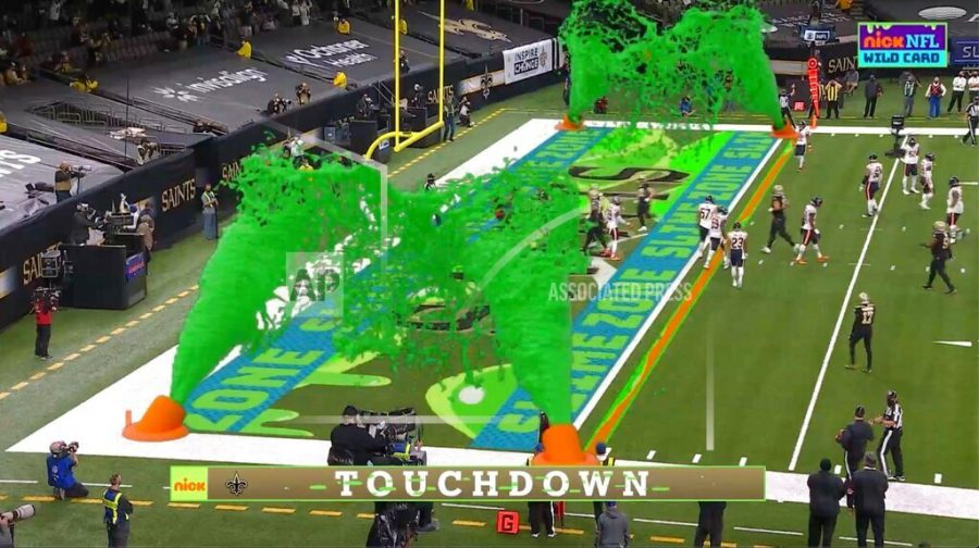 Virtual slime cannons go off in the end zone after a touchdown during Nickelodeon's kid-focused broadcast of the NFL wild-card playoff game between the Chicago Bears and New Orleans Saints at the Superdome, Sunday,  Jan. 10, 2021 in New Orleans. The positive reviews for Nickelodeon's kids-focused broadcast of last Sunday's NFL playoff game showed the potential of alternate broadcasts of sporting events. The success of that broadcast has led to many wondering what other sports it could expand to and when we might see it again in the NFL? (CBS/Viacom via AP)