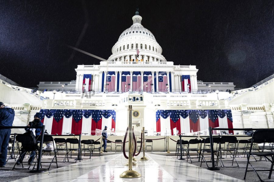 A light rain falls at the U.S. Capitol as preparations continue prior to the 59th inaugural ceremony for President-elect Joe Biden and Vice President-elect Kamala Harris in Washington on Wednesday, Jan. 20, 2021. (Erin Schaff/The New York Times via AP, Pool)