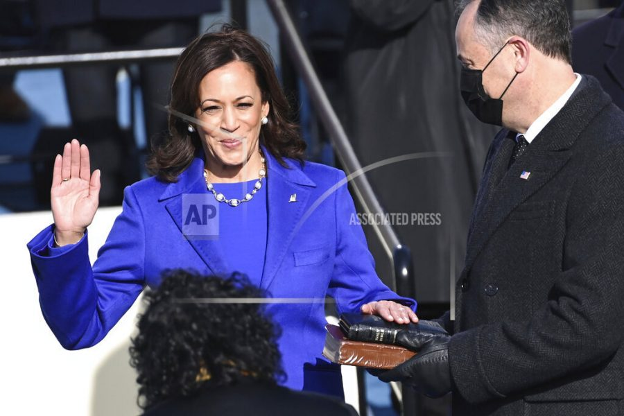 Kamala Harris is sworn in as vice president by Supreme Court Justice Sonia Sotomayor as her husband Doug Emhoff holds the Bible during the 59th Presidential Inauguration at the U.S. Capitol in Washington, Wednesday, Jan. 20, 2021.(Saul Loeb/Pool Photo via AP)