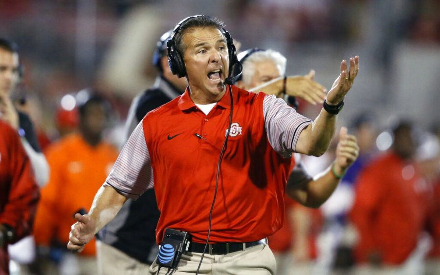 FILE - In this Sept. 17, 2016, file photo, Ohio State head coach Urban Meyer shouts from the sideline in the fourth quarter of an NCAA college football game against Oklahoma in Norman, Okla. A person familiar with the search says Urban Meyer and the Jacksonville Jaguars are working toward finalizing a deal to make him the team