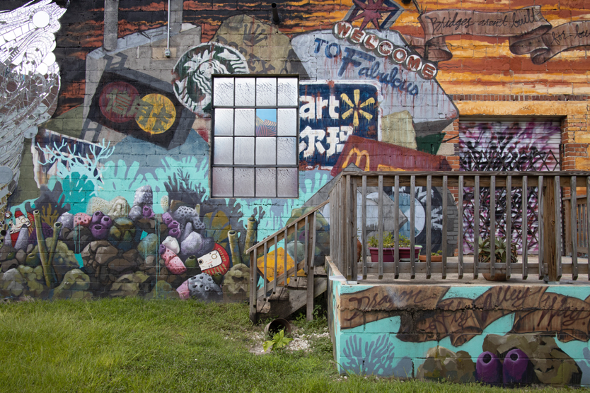 "Photo from Brody's series ""Public Domain"" - Welcome to Fabulous Art (Mural collaboration by Dustin Harewood, Elena Ohlander and Shaun Thurston; mirror mosaic by Christy Frazier, Jacksonville, FL), 2020, Archival Inkjet Print / Image courtesy of Ally Brody"