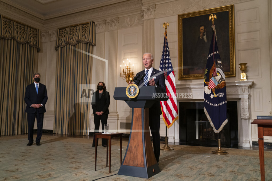 Special Presidential Envoy for Climate John Kerry, left, and Vice President Kamala Harris, center, listen as President Joe Biden delivers remarks on climate change and green jobs, in the State Dining Room of the White House, Wednesday, Jan. 27, 2021, in Washington. (AP Photo/Evan Vucci