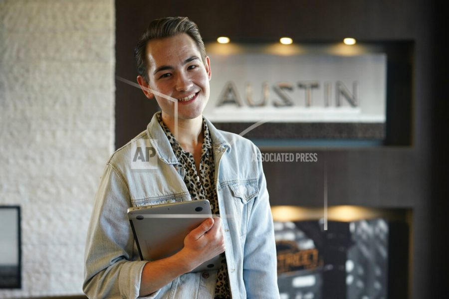 Connor Payne poses for a photo near his home, Wednesday, Jan. 13, 2021, in Austin, Texas. Payne, 23, moved to Austin in the summer of 2019 and was still getting to know the city and making new friends when the pandemic hit. He had been working for an event planning company but got laid off this month. (AP Photo/Eric Gay)