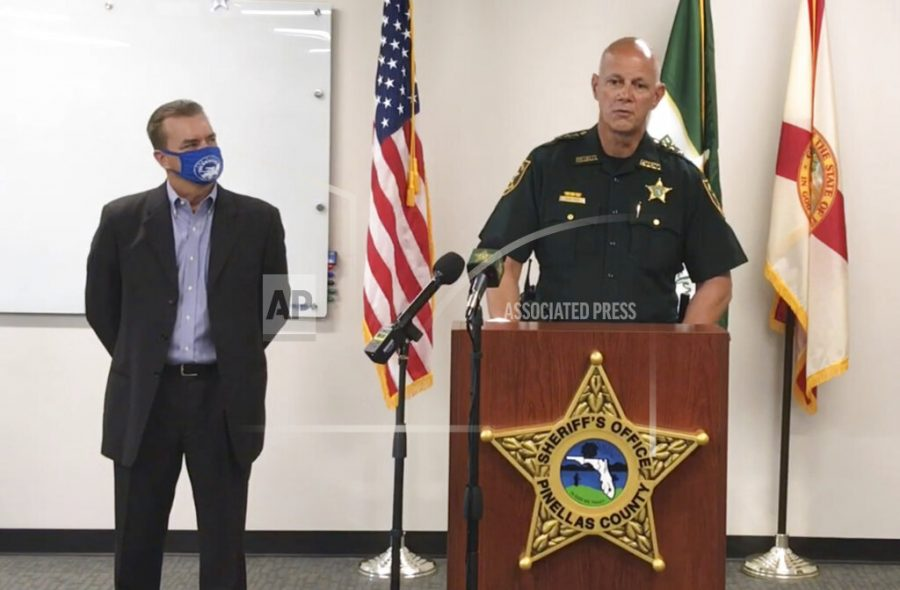 In this screen shot from a YouTube video posted by the Pinellas County Sheriff's Office, Pinellas County Sheriff Bob Gualtieri speaks during a news conference as Oldsmar, Fla., Mayor Eric Seidel, left, listens, Monday, Feb. 8, 2021, in Oldsmar, Fla. Authorities say a hacker gained access to Oldsmar's water treatment plant in an unsuccessful attempt to taint the water supply with a caustic chemical. (Pinellas County Sheriff's Office via AP)